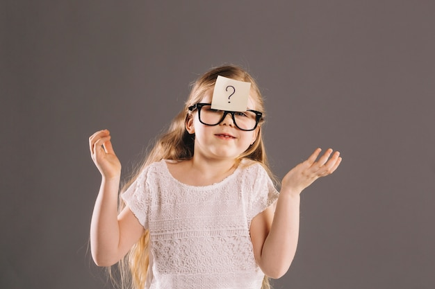 Puzzled girl in glasses Free Photo