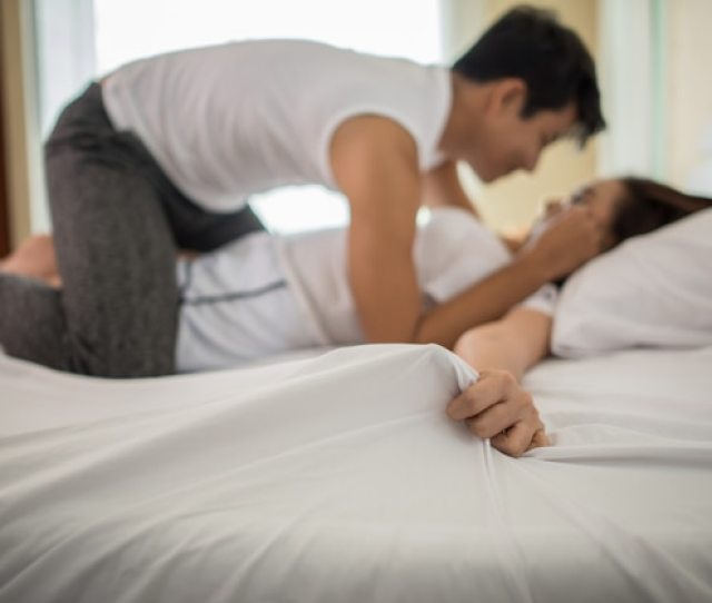 Romantic Happy Couple In Bed Enjoying Sensual Foreplay Free Photo