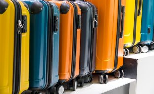 Side view of colorful suitcases Free Photo