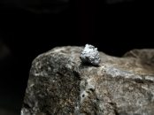 Silver nugget on the big stone Premium Photo