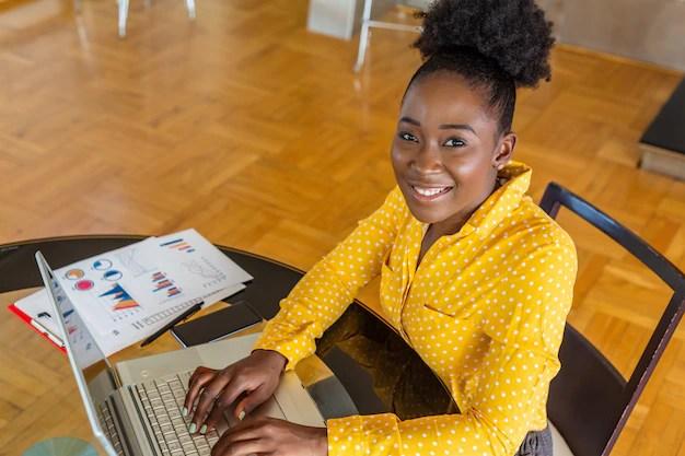 Smiling businesswoman using computer in office Premium Photo