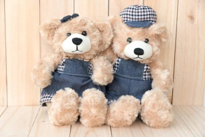two teddy bears on wood background Free Photo