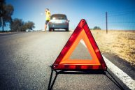 Warning triangle in a car breakdown Free Photo