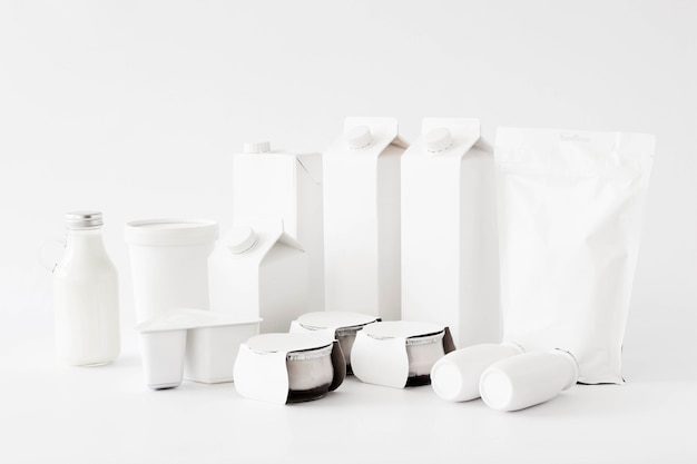 White carton packages and bottles for liquid Free Photo