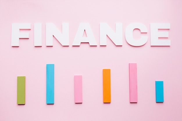 Free Photo | White finance text over the colored bar graph on pink  background
