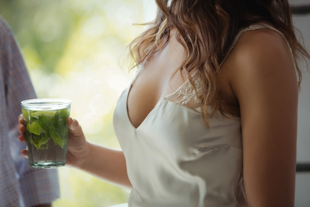 Woman holding a cocktail glass in restaurant Premium Photo