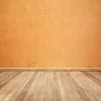 Wooden floor with an orange wall background Photo   Free ...