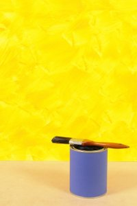 Yellow wall with paint can Photo | Free Download