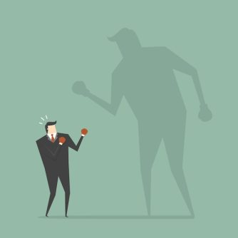 Businessman boxing with a shadow Free Vector Confident Attitude