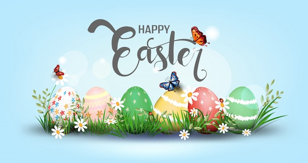 Happy easter element for design. eggs in green grass with white flowers isolated Premium Vector