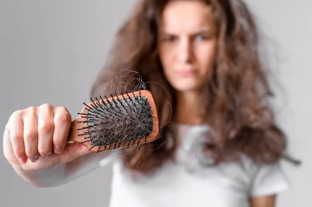 problèmes de cheveux : cheveux cassées sur une brosse
