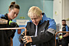 Prime Minister Boris Johnson looks at a copper pipe during a visit to a British Gas training academy