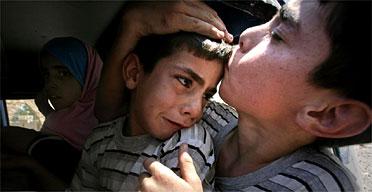 Children flee the village of Aitaroun in South Lebanon. Photograph: Sean Smith/Guardian