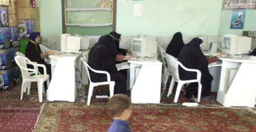 Iranian women use the internet in village of Qarn Abad, 240 miles north-east of Tehran