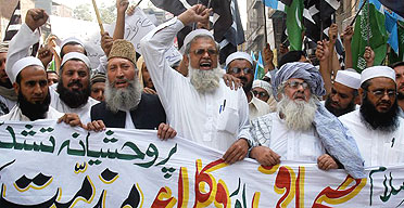 Opponents of Pakistan's president, General Pervez Musharraf, demonstrate in Peshawar