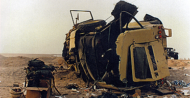 The wreckage of the Land Rover after it was struck by the tank transporter.