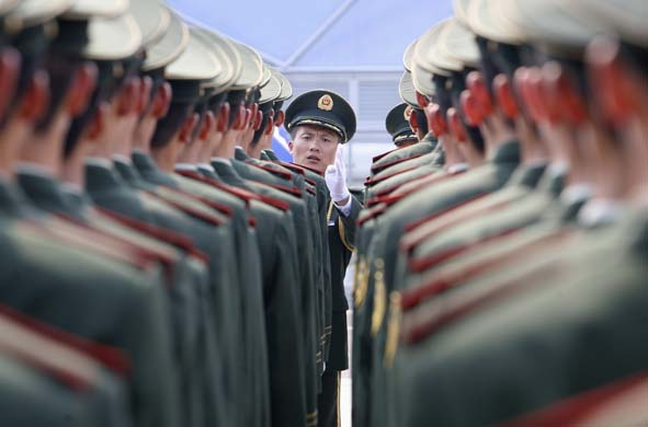 Paramilitary policemen stand in line Beijing