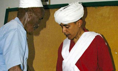 Barack Obama, right, is dressed as a Somali elder by Sheikh Mahmed Hassan, left, during his visit to Wajir in northeastern Kenya, near the borders with Somalia and Ethiopia. Photograph: AP