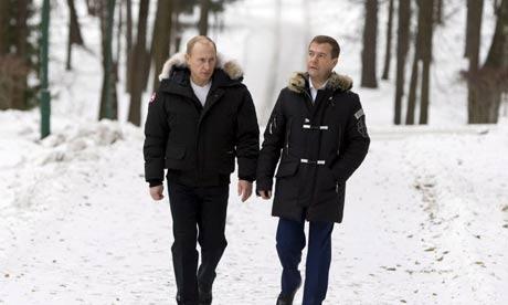 Vladimir Putin and Dmitry Medvedev on a stroll near Moscow. Photograph: Alexander Zemlianichenko/EPA