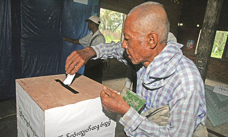 An unidentified man votes in Burma's controversial referendum on a new military-drafted constitution