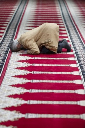 Muslim praying in Prayer Hall in Amman airport, Amman, Jordan, Middle East