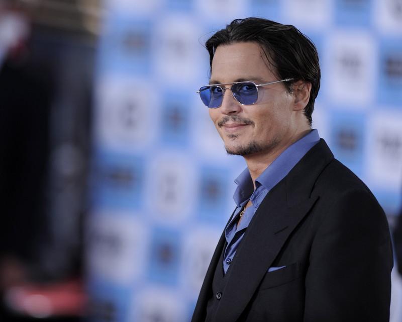 Actors arrive for the 'Public Enemies' premiere in Los Angeles, California.