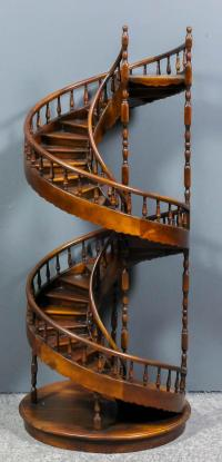 A modern mahogany architectural model of a spiral staircase