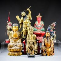 A Chinese carved giltwood seated figure of a Changmei Lohan,
