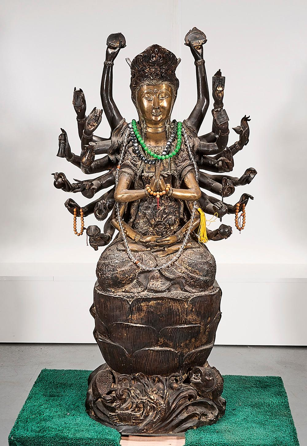 CHINESE METAL MULTI-ARMED SEATED DEITY