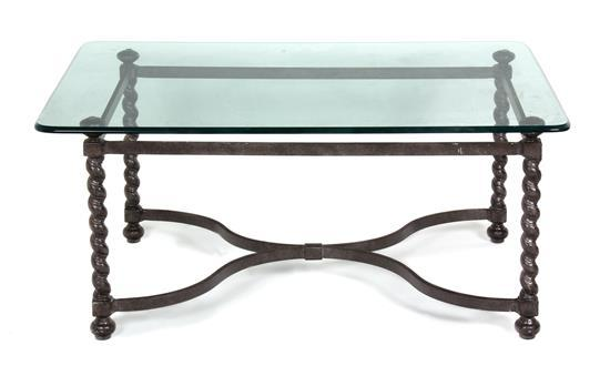 a wrought iron glass top coffee table height 17 1 2 x width 40 x depth 30 1 4 inches