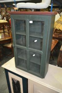 A small painted medicine cabinet