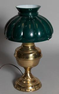 Semi-antique brass desk lamp with green glass shade.