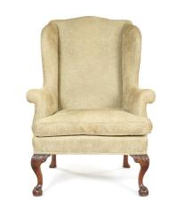 A George III carved mahogany wing armchair