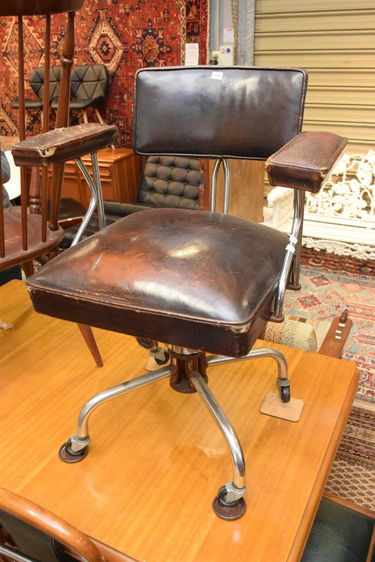 AN INDUSTRIAL OFFICE CHAIR IN BROWN LEATHER