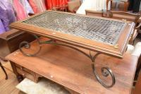A WROUGHT IRON AND TIMBER CLASSICALLY STYLED COFFEE TABLE