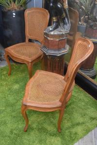A PAIR OF LOUIS XVI STYLE RATTAN CHAIRS