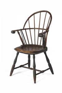 KNUCKLE-ARM SACK BACK WINDSOR CHAIR IN BLACK PAINT.