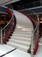 China Curved Stairs with Grill Design Balustrade and ...