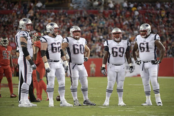 New England Patriots offensive linemen Nate Solder (77), left, Joe Thuney (62), David Andrews (60), Shaq Mason (69) and Marcus Cannon (61) wait to huddle during the first half of an NFL football game against the Tampa Bay Buccaneers Thursday, Oct. 5, 2017, in Tampa, Fla. (AP Photo/Phelan M. Ebenhack)
