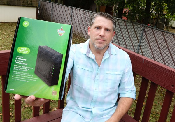 John Covino with his own cable modem at home in Parsippany.