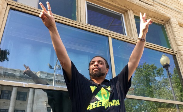 """Ed """"NJ Weedman"""" Forchion reacts to someone who beeped their horn in support as he talked in front of his shuttered restaurant Friday, May 25, 2018 in Trenton, a day after he was acquitted of witness tampering and was released from jail. (Kevin Shea 