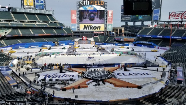 A hockey rink is set up on the infield at Citi Field in New York on Sunday, Dec. 31, 2017. The Buffalo Sabres play the New York Rangers on Monday in the NHL's New Year's Day game. Both teams practiced on the ice with the temperature around 16 degrees, the same as is forecast for the start of the game on Monday.