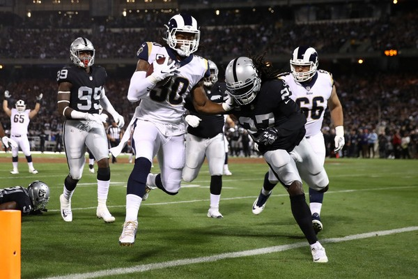 New Raiders coach Jon Gruden begins his attempt to turn the franchise around. The Rams are loaded and seen as a Super Bowl contender.