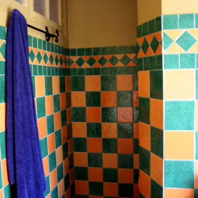 installer une barre de douche guide