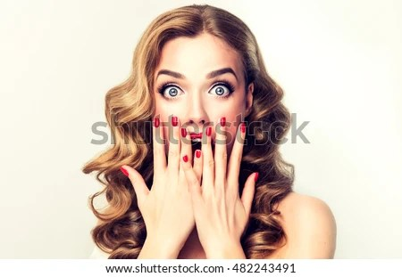 woman surprise showing product autiful girl with curly hair pointing to the side presenting