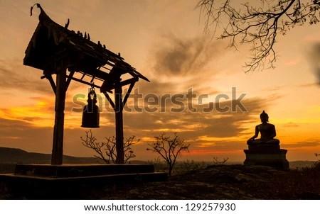 Buddha statue in sunset at  Phrabuddhachay Temple Saraburi, Thailand. - stock photo