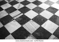 Black And White Checkered Marble Floor Pattern Stock Photo