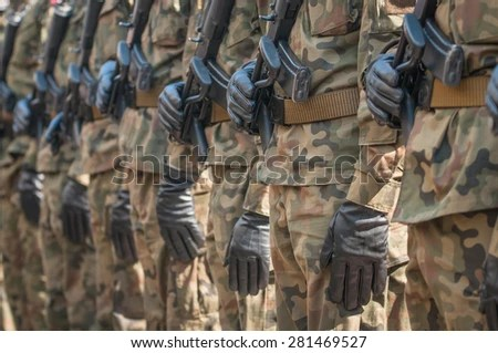 Army parade - armed soldiers in camouflage military uniform