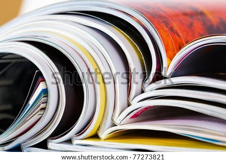 stock photo : Closeup background of a pile of old magazines with bending pages