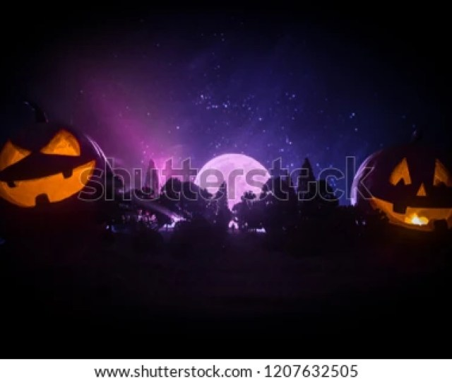 Halloween Concept With Glowing Pumpkins Strange Silhouette In A Dark Spooky Forest At Night